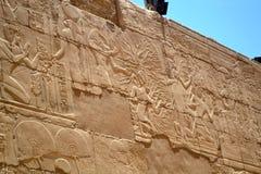 Egyptian hieroglyphs on an ancient stone wall royalty free stock photos