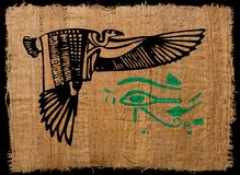 Ancient Egyptian eagle on papyrus with Horus eye. Ancient Egyptian eagle on papyrus texture with Horus eye stock photography