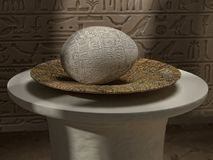 Ancient Egyptian egg with hieroglyphs. 3D rendering of ancient Egyptian egg with hieroglyphs on old plate against the wall with hieroglyphs Royalty Free Stock Photography