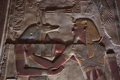 Ancient Egyptian engravings. Seti wearing a blue crown burning incense over an offering Royalty Free Stock Photos