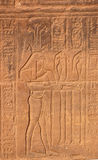 Ancient Egyptian god Hapy. Carving on the wall of the Temple of Isis at Philae of the Ancient Egyptian god Hapy. God of the Nile flood and the embodiment of royalty free stock photo