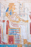 Ancient Egyptian Goddess Mut. An Ancient Egyptian carved hieroglyphic painting of the goddess Mut.  One of the symbolic mothers of the king, she is shown with a Royalty Free Stock Photos