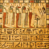 Ancient Egyptian gods and hieroglyphics. Painted on stone Stock Image