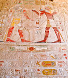 Ancient Egyptian Gods and hieroglyphs. In carved wall stock photography