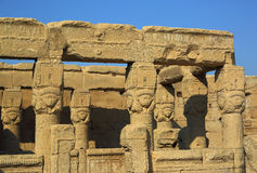 Ancient Egyptian Hathor sculptures in temple of Dendera. Ancient Egyptian fertility goddess Hathor sculptures on the pillars in the temple of Dendera Stock Image