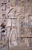 Ancient Egyptian Heiroglyphics, Egypt. The god Horus, carved on an ancient wall at the Temple of Karnak in the city of Luxor, Egypt. Old ruins of ancinet Egypt royalty free stock image