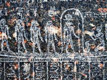 Ancient egyptian hieroglyph carved in black stone Stock Images