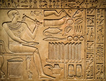 Ancient egyptian hieroglyph. Depicting a pharaoh, animals and signs stock photo