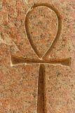 Ancient egyptian hieroglyphic symbol Ankh. `Key of Life`, `Eternal Life`, `Egyptian Cross` carved on the stone stock photo