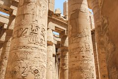 Ancient Egyptian Hieroglyphs And Symbols Carved On Columns Of The Complex Of The Karnak Temple Royalty Free Stock Images