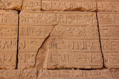 Ancient Egyptian hieroglyphs carved on the stone. The roof of Karnak temple. Royalty Free Stock Photos