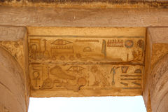 Ancient Egyptian hieroglyphs carved on the stone. The roof of the temple at Karnak Stock Image