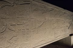 Ancient egyptian obelisk on side in Karnak temple at night Royalty Free Stock Image