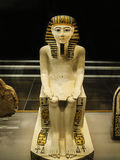 Ancient Egyptian Painted Figure. Small Painted Pharonic figure on display in Turin Italy Stock Images