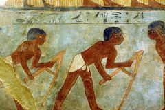 Ancient Egyptian painting in Louvre. A photograph showing the beautiful drawing art of ancient Egypt, showing people workers at farming or agricultural jobs Royalty Free Stock Photo