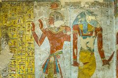 Ancient egyptian painting of two gods in a tomb in the valley of stock photo