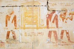 Ancient Egyptian Priests with golden ark. An ancient egyptian wall painting showing priests carrying a golden ark. Wall of the Temple of Rameses II at Abydos royalty free stock photography