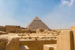 The ancient Egyptian Pyramid of Khafre with ruins, tombs and monuments in Giza stock image