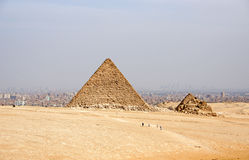 Ancient Egyptian pyramids of Giza against sandy sky Stock Images