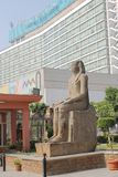 Ancient Egyptian statue in the courtyard of the Cairo Museum on the background of a modern building. royalty free stock photo