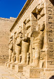 Ancient egyptian statues in the mortuary Temple of Ramses III Royalty Free Stock Photography