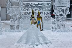 Ancient Egyptian theme with coloured figures and diminutive pyramid Stock Images