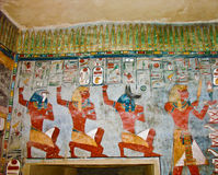 Ancient Egyptian wall painting. Ancient Egyptian Gods and hieroglyphs in wall painting stock photo
