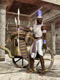 Ancient Egyptian warrior with a chariot. In front of a temple stock illustration