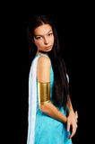 Ancient Egyptian woman - Cleopatra. Pretty woman in egyptian queen costume. Isolated on black Royalty Free Stock Photos