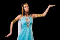 Ancient Egyptian woman - Cleopatra. Pretty woman in egyptian queen costume. Isolated on black Royalty Free Stock Photography