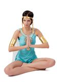 Ancient Egyptian woman - Cleopatra in zen position Stock Photography
