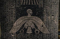 Ancient Egyptian writing, alien-like figure Royalty Free Stock Image