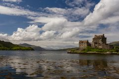 Ancient Eilean Donan Castle reflected in the water of a loch in royalty free stock images