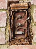 Ancient electrics,echoes from the past. Cover entirely missing. Layers of rust, well beyond use royalty free stock photography
