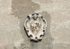 Ancient emblem. On stone wall Stock Photography