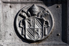 Ancient emblem of the Vatican City in Rome (Italy). Iron plate stock photography