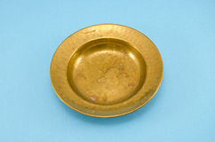 Ancient and empty brass plate Stock Image
