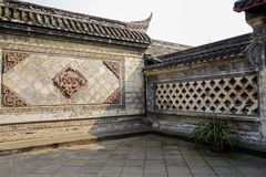 Ancient enclosures with stone embossment. On sunny day, Chengdu,China Royalty Free Stock Images