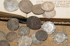 Ancient England silver coins with portraits of kings on the old Royalty Free Stock Photo