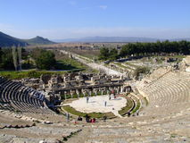 Ancient Ephesus theatre. Ephesus is an ancient Ionian Greek city; its ruins lie near the modern village of Selcuk in West Turkey. This big ancient theatre is Stock Photography