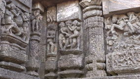 Ancient erotic sacred art sculptures on Konark sun temple, Odisha, India stock video