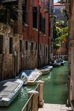 Ancient Facade along Typical Water Canal with Boats in Venice, I Royalty Free Stock Photo