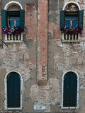 Ancient Facade along Typical Water Canal in Venice, Italy Stock Image