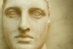 Ancient face. Ancient sculpture close-up portrait at old background Stock Images