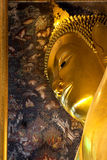 Ancient face of buddha hidden with eye contact. Stock Images