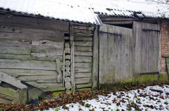 Ancient farm barn wall with wooden door Stock Photography