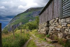 Ancient farmhouse. The view from this ancient farmhouse is spectacular. The Norwegian landscape and distant fjord create a peaceful and natural working Royalty Free Stock Photos