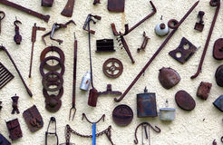 Ancient farming tools hanging on the wall of the rural House Royalty Free Stock Image