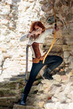 Ancient female archer. With bow and arrow Stock Photo