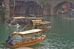 Ancient Feng Huang. China ,April 12, 2013:  evening passenger ship royalty free stock photo